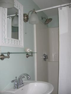 Bath with rainfall shower head
