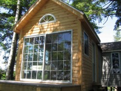 Front of cabin huge glass doors