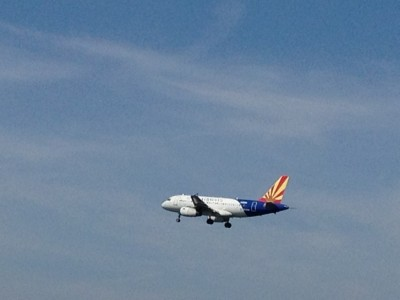 Watch planes land at Logan